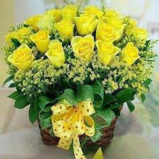 24 yellow roses in a basket