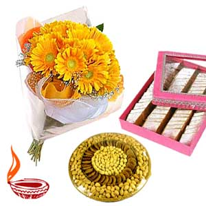 1/2 kg Dry fruits with 1/2 kg kaju katli and 12 gerberas