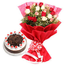 1 kg black forest cake and 15 roses bouquet