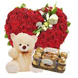 50 red roses heart 1 foot teddy bear and 16 ferrero chocolates