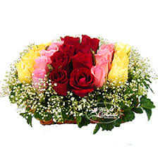 18 Mixed color flowers arrangement in a basket