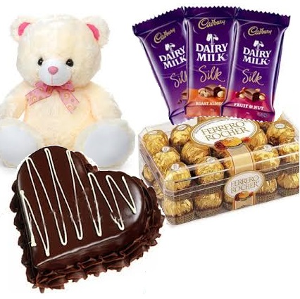 16 Ferrero chocolates with 6 inches Teddy 1 Kg chocolate heart cake and 3 Silk